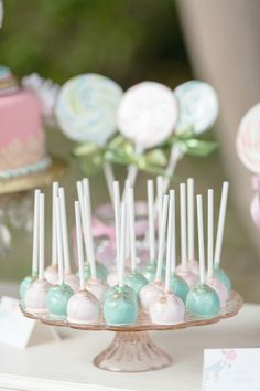 carousel cake pops #cakepops http://www.weddingchicks.com/2013/12/03/carousel-wedding-ideas/