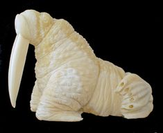A truly lovable walrus carved from fossilized walrus tusk, with impressive tusks itself by Ben Pungowizji, Alaskan Eskimo - Now has a new home