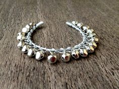 Wrapped Jingle Bell Bangle:  Handmade, jingle bell, aluminium, wire wrapped bracelet.