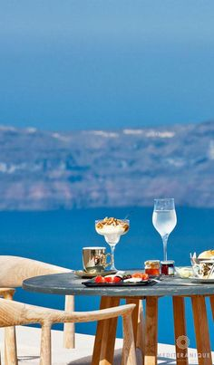 Breakfast overlooking the Santorini Caldera at the Andromeda Gold Suites