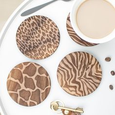 Wild Animal Print Coasters | Create Gift Love £30  Bring some fun to your coffee table, with these Wild Animal Print Coasters.  http://www.creategiftlove.co.uk/collections/personalised-wood-coasters/products/wooden-animal-print-coaster-set  #animalprint #coasters #creategiftlove