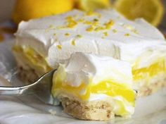"""Lemon Lush Dessert (Cupcake Diaries) [""""A cookie crust is layered with a creamy lemon pudding, sweet cream cheese, and a fluffy whipped topping. This dessert is perfect for spring and summer! Lemon Lush Dessert, Lemon Desserts, Great Desserts, Brownie Desserts, Lemon Recipes, Sweet Recipes, Delicious Desserts, Yummy Food, Dessert Healthy"""