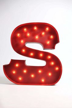 "Marquee Alphabet Light $179  * Metal, light components  * Wipe clean  * Imported  * Simple assembly required  * Light bulbs included  * Sizes will vary by letter: 19""w, 4""d, 24""h - 27""w, 4""d, 24""h"