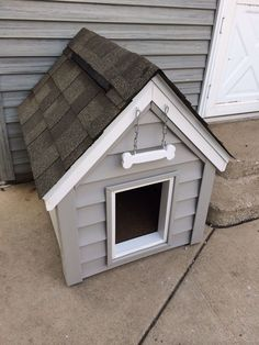 DIY dog house, dog house is insulated with a ridge vent. Also has a magnetic door closer, vinyl siding and capped with aluminum.
