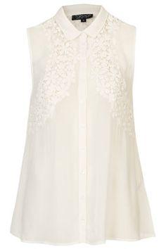 Flower Crochet Detail Shirt (Sleeveless shirt with floral crochet detail and front buttons. 100% Viscose.) $68