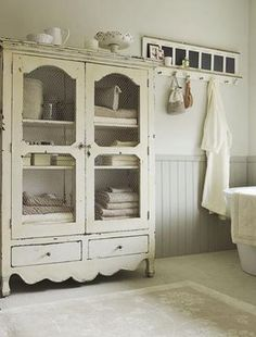 Different color bead board a few shades lighter wall. Also love the cabinet with the chicken wire!