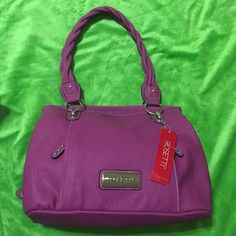 NWT Rosetti Purple Purse Brand new Rosetti purse. I had it stored and handle had something stuck to it so 2nd & 3rd picture shows how it looks. Its a small part but not extremely noticeable. It has three big compartments to store lots of items. One main one is with zipper and others are with magnet clasp. The rest of the bag is very pretty and i looked for any other defects but none that i could tell. Original price was $39.99 plus tax 8.25%. Further questions do comment below. Don't do…
