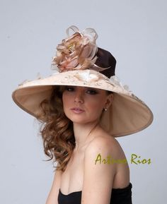 SO Pretty!  I wish I could afford this!  Champagne/bronze Couture Derby Hat, Kentucky derby Hat. $230.00, via Etsy.