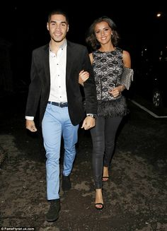 Stepping out in style: Former TOWIE star Lucy wore a patterned sleeveless top, featuring a...