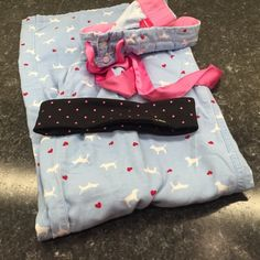 ❤️VS❤️ PJ Pants and Sport Headband! Adorable and cozy light blue pj pants, size xs but run pretty big. Closer to a medium. And a cute black with pink polka dots headband. It has the plastic on the inside to keep from sleeping! Love both of these :) Victoria's Secret Intimates & Sleepwear Pajamas