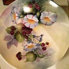Porcelain painting of a morning glories and berries on porcelain plate by porcelain artist and china painting teacher, Jane Wright.