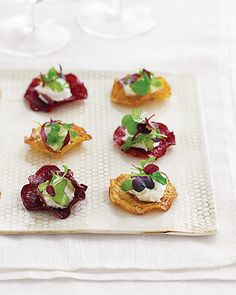 For a finger-friendly take on classic beet-and-goat-cheese salad, serve fried beet chips topped with a dollop of the tangy cheese and vinaigrette-laced micro greens. They make perfect hors d'oeuvres -- crispy instead of juicy beets means no one will be caught red-handed.