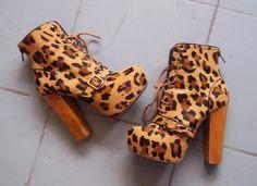 Meeee-yow. Leopard platform lace-up booties