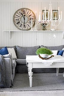 ok....the accents are tacky, but the white with the gray couch is really clean and not too feminine