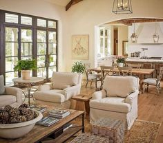 Den/Breakfast room/kitchen combo. Love the neutrals and layout.
