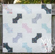 The bow tie quilt block makes the perfect quilt for a baby boy, I think. It's sweet and simple and goes with just about any fabric. But it makes an adorable little girl quilt too... so let's not discriminate!