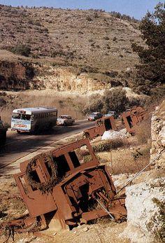 Tel Aviv-Jerusalem road, with destroyed Jewish convoy left as memorial.