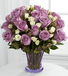 Wonderland Purple Roses Bouquet at Send Flowers. A large purple roses arrangement with touches of petite white spray roses delivered in a thick purple vase. Cheap Flowers, Unusual Flowers, Purple Flowers, Beautiful Flowers, Fresh Flowers, Colorful Flowers, Spring Flowers, Pastel Bouquet, Rose Bouquet
