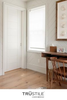 This cozy home office space is brought to life with warm wood accents and delicate white details. We love how the paneled door and paneled walls play off of each other. Cozy Space, Contemporary Interior Design, Warm Wood, Contemporary Interior, Cozy House, Contemporary Doors, Wood Accents, Aesthetic Bedroom, Cozy Home Office
