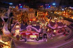 Our Yearly Christmas Village. Lionel train, trolley, 150 houses make up this magical display