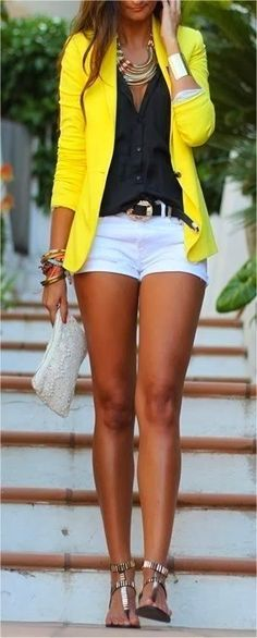 White shorts, yellow blazer, black top...