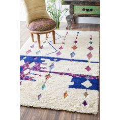 This handmade wool area rug uses bold, eye-catching colors that any child will love. Plush wool shag pile offers great comfort under foot.