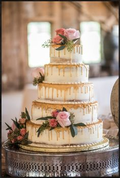 5 Tier Semi-Naked Wedding cake with gold drip and fresh flowers