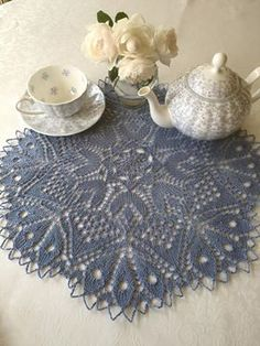 Tea set is Charming Bluebells by Maxwell and Williams; doily is 'Klee' designed by Herbert Niebling, knitted by Bronwyn Parry;