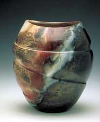 beautiful pit fired pot. potters use salts to encourage nice colors during pit firings.