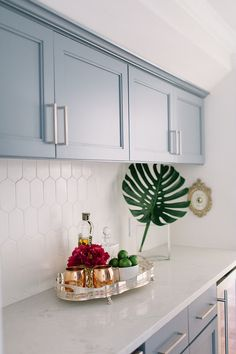 tiles Backsplash Butler's pantry with blue grey cabinets, Sherwin Williams Storm Cloud, marble-looking countertop and elongated hexagon tile backsplash Blue Kitchen Cupboards, Backsplash Kitchen White Cabinets, Grey Cabinets, New Kitchen, Hexagon Tile Backsplash, Grey Kitchen Tiles, Kitchen Counters, Backsplash Ideas, Kitchen Paint