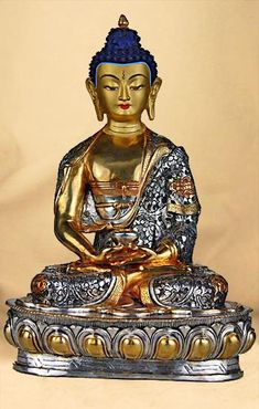 Buddha Amitabha. Statue of Buddha Amitabha with gold and silver & engravings done by hand. Buddhist Thangkas, Statues and Mandalas. Marvelous figure from Snow Lion. http://www.thangkas.com/statues/Buddha-Statue.php