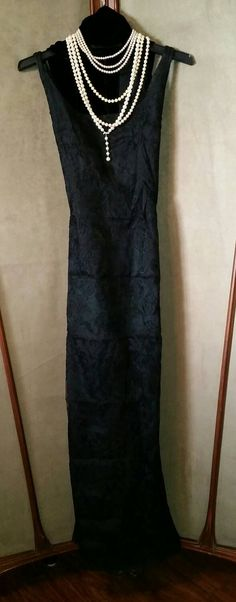 Check out this item in my Etsy shop https://www.etsy.com/listing/219715769/gorgeous-formal-full-length-black-lace