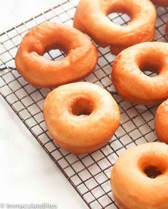 Krispy Kreme Doughnut Recipe(Copy Cat) -- Light and fluffy donuts topped with a rich glaze on top that will melt in your mouth. Tastes as good as the store-bought Krispy Kremes! Easy Donut Recipe, Donut Recipes, Dessert Recipes, Cooking Recipes, Krispy Kreme Donut Recipe, Protein Donuts, Grilled Prawns, Homemade Donuts, Recipe Collection