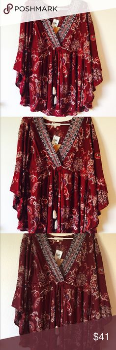 🌺NWT Gorgeous Red V-Neck Flowy Blouse!🌺 This is a GORGEOUS flowy blouse made by Sky and Sand! This has a V-neck design and is a size large!                                             Comes NEW WITH TAGS!🎉                             Retail price is $48.                                             Will except offers!                                               Any questions please ask before purchasing! 🌴 Sky and Sand Tops Blouses