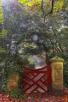 .love this red garden gate.