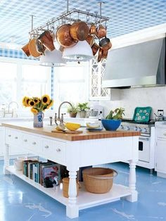 Create your own elevated art with decorative ceilings and floors. Try painted stripes, botanical collages, or nautical charts. Anchor themed wallpaper and a stenciled motif on painted wood floors adds a playful touch to this classically coastal kitchen. Painted Kitchen Floors, Painted Floors, Kitchen Paint, Kitchen Flooring, New Kitchen, Kitchen Decor, Painted Wood, Kitchen Ceilings, Awesome Kitchen