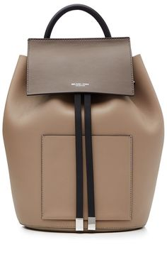 b1c0bcc2 Leather Streamlined and super chic, this smooth leather backpack from  Michael Kors Collection is an investment accessory that won't date.