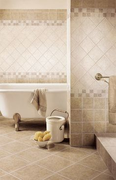 Always have liked this pattern, you don't have to have expensive accent pieces, just use differnt color/size tiles.