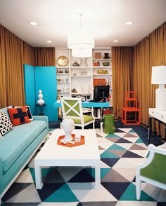 Living Room Photo - A geometric rug and a blue couch in an office space