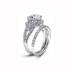 18k white gold and diamond ring with round diamond center stone and matching band, Michael Beaudry
