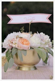 Pink and gold centerpiece by lovely little details. Photo by Edyta Szyszlo