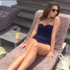 Beach babe: Elizabeth Hurley was back to her old figure-flaunting tricks once again as she shared a candid throwback snap to her Maladives breakway on Instagram