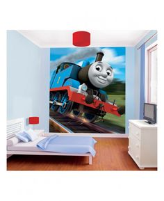 Create an instant feature wall in your room with this beautifully detailed Thomas & Friends Wall Mural! The colourful mural is printed onto high quality paper to ensure a fantastic finish and is made up of 8 panels for easy application. The mural is a stunning image of Thomas flying down the tracks and is a simple way to give a room a Thomas the Tank Engine theme