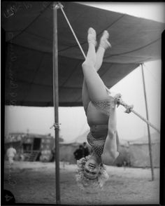 "Circus performer Ruby Woods poses beneath the Big Top, Los Angeles, 1935. ""This was most likely taken in anticipation of the Al G. Barnes Circus performances in Los Angeles running throughout March and April of 1935."""