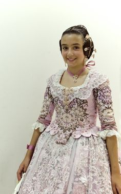 Traje de valenciana infantil confeccionado por Aguas de Marzo indumentaria Trajes -Folkloric dress of Valencia, Spain called falla, and their wearers are falleras. This regional folk dress is still brought out at festivals & holidays by ladies of the region like the dirndl in Germanic & Bavarian regions. First based on Baroque fashions when Spain achieved it's greatest power and weatlth through colonialism, mercantilism, and slavery inflicked abroad, the costumes are nostalic reminder of…