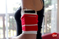 DIY arm band for phone/ipod from tube sock.  Step 1: find sock with at least 8in long 'tube' Step 2: cut off bottom of sock, leaving only tube Step 3: Pull tube on arm inside out, folding it in half so visible part is right side out Step 4: using the arm band as a pocket, insert your phone!  (you can also stitch up the sides of where the phone is to secure it a bit more)
