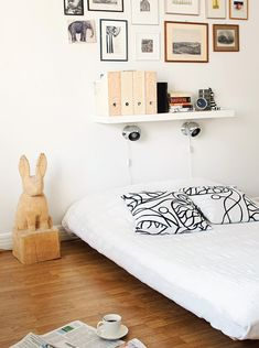 a clean uncluttered look that i like but still it has lighting for night reading;a shelf for display and small framed photos and artwork to finish the creation of the bedroom niche. NICE