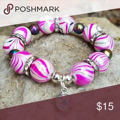 Pink Marbled Chunky Bracelet Hot Pink & White Chunky Cuff w/Multi-Colored and rhinestone spacers. Finished off with a silver iridescent charm. Accessories