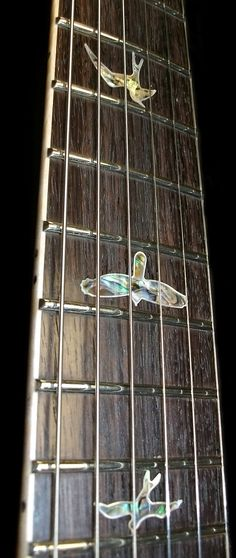 bird inlays... I will have a guitar with these one day!