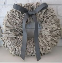 DYI Wreath! It's torn linen or cotton of your choice, threaded through a bent coat hanger! So easy and cute.